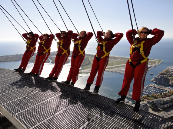 CN Tower, CN Tower Edge Walk, Toronto, Lake Ontario, women, sunny, day, photograph, red jumpsuits, harness