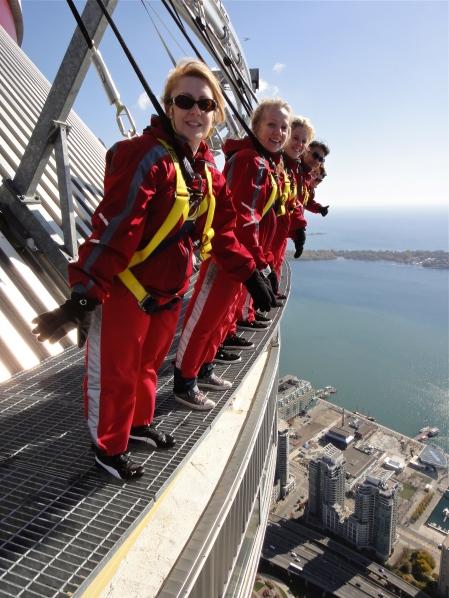 CN Tower, Toronto, CN Tower Edge Walk, Canada, women, red jumpsuits, sunny, Lake Ontario